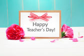 Happy Teachers Day card with carnations — Stock Photo