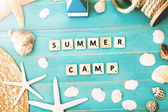 Wood Blocks on a Table for Summer Camp Concept — Stock Photo