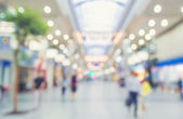 Blurred shopping mall with people walking — Stock Photo