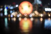 Night harbor lights with ferris wheel — Stock Photo