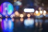 Harbor lights backdrop with ferris wheel — Stock Photo