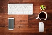 Neat workstation on a wooden desk — Stock Photo