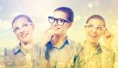 Women in glasses on city background — Stock Photo