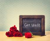Get Well Text on Small Chalkboard with Roses — Stock Photo