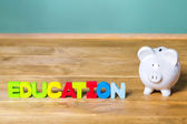 Education theme with piggy bank — Stock Photo
