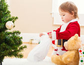 Little girl playing with her new Christmas toys — Stock Photo