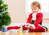 Happy little girl playing with her Christmas toys — Stock Photo