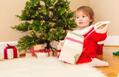 Little toddler girl opening Christmas presents — Stock Photo