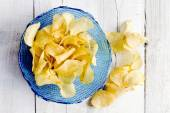 Potato chips inside blue bowl — Stok fotoğraf