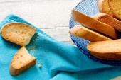Dried biscuits with crumbs over blue napkin — Stock Photo