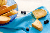 """Dried biscuits called """"lagaccio""""  with crumbs over blue napkin — Stock Photo"""