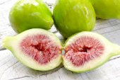 Ripe figs close up over white wood — Stock Photo