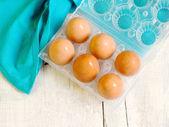 Fresh eggs inside egg basket — Stock Photo