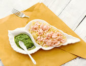 Pasta with steamed salmon and pesto sauce — Stock Photo