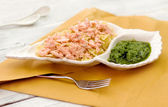 Pasta recipe with steamed salmon and pesto sauce — Stock Photo