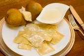 Home made ravioli stuffed with pear and cheese sauce — Stock Photo