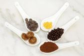 Cocoa, chocolate praline, marron glacee, cacao and golden edible — Stock Photo