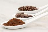 Cocoa powder, chocolate drop and praline — Stock Photo