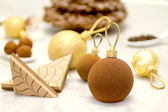 Christmas chocolate baubles ahainst christmas sweets background — Stock Photo