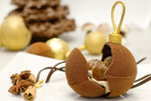 CHOCOLATE CHRISTMAS BAUBLE with delicious stuffing — Stock Photo