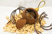 Chocolate Christmas bauble over crumble — Stock Photo