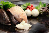 Raw scallops in the foreground with artichokes, celery and radis — Stock Photo