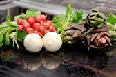 Raw seasonal vegetable over professional plate induction — Stock Photo