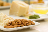 Food ingredients with almond in the focus in the foreground — Stock Photo
