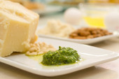 Food ingredients with pesto sauce in the focus in the foreground — Stock Photo