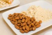 Almond dried fruit and almond flour — Stock Photo