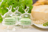 Pesto macaroons with pesto sauce ingredients in the background — Stock Photo