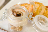 Appetizers with salt croissant and anchovy fillet inside glass j — Stock Photo