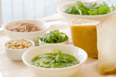Rocket pesto sauce with ingredients and home made  egg pasta — Stock Photo