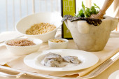 Gourmet recipe ingredients  with cuttlefish, pine seed, rocket a — Stock Photo