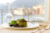 Serving dish with home made pasta with rocket pesto and pine nut — Stock Photo