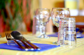 Restaurant table setting with colorful cloth — Stock Photo