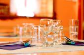 Warm indoor restaurant table setting  — Stock Photo