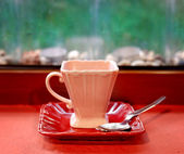 Pink old style coffee cup against country background — Stock Photo