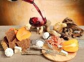 Wine tasting with persimmon, meringue, parma ham, cereal bread a — Stock Photo