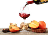Winter composition with persimmon and red wine  — Stock Photo