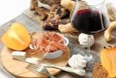 Winter gourmet composition with persimmon, meringue, cereal brea — Stock Photo