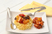 Egg pasta with peppers and eggplant — Stock Photo