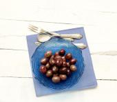 Olives inside blue glass bowl — Stock Photo