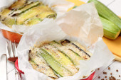 Zucchini parmigiana close up with ingredients and spices — Stock Photo