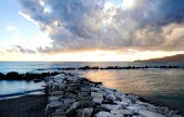 Sunset with stormy clouds over seascape — Stock Photo