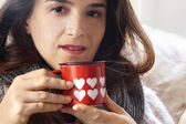 Portrait of alluring girl drinking something from Valentine deco — Stock Photo