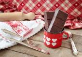 Modica chocolate bar inside hearts decorated mug with kitchen ut — Stockfoto