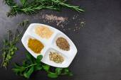 Aromatic herbs and spices over slate sheet — Stock Photo