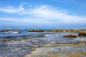 Seascape of Livorno coast with dam and lighthouse in the backgro — Stock Photo