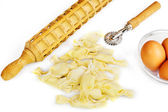Homemade ravioli with ingredients and kitchen tools — Stock Photo